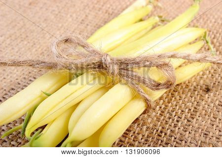 Stack of beans tied with string lying on jute canvas healthy food and nutrition
