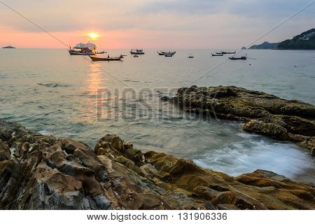 Long Exposure of Sunset and rock at Kalim beach near Patong beach Phuket Thailand