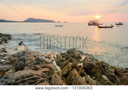 Long Exposure of Sunset and rock at Kalim beach Phuket Thailand