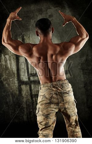 Male bodybuilder showing perfect back muscles.