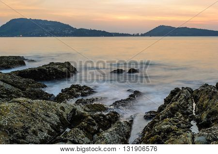 Long Exposure of beautiful Sunset at Kalim beach Phuket Thailand
