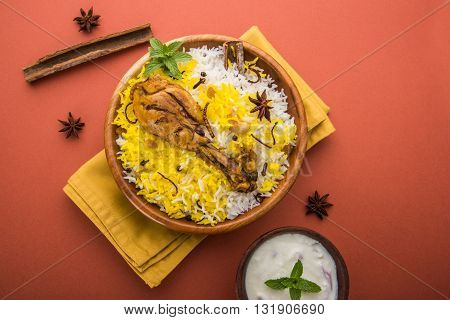 Chicken biryani made in authentic basmati rice and big leg piece, selective focus