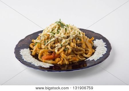 Traditional uzbeck noodles dish with cheese and herbs