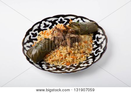 Traditional asian pilaf dish with meat and dolma