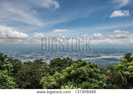 A view from the top of Wat Phra That Doi Suthep in Chiang Mai, Thailand. The top of Wat Phra That Doi Suthep temple offers an amazing view of the city and looks gorgeous on a sunny day.