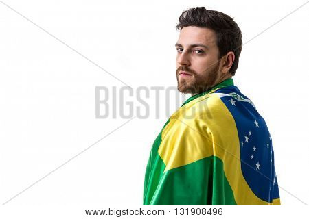 Young man holding Brazilian flag