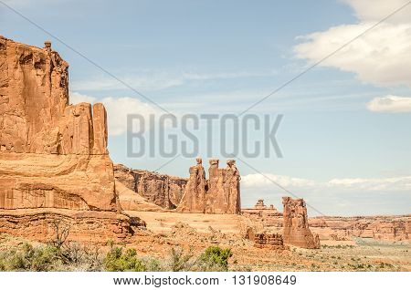 Among the named formations in Arches are the Three Gossips in the middle and Sheep Rock to their right