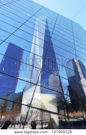New York City - april 15: The One World Trade Center and memorial site in New York with blue sky on April 15 2016