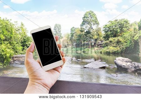 Hand Hold Blank Empty Screen Mobile Phone Or Cellphone In Relax Day At Nanure Waterfall Or River Sce