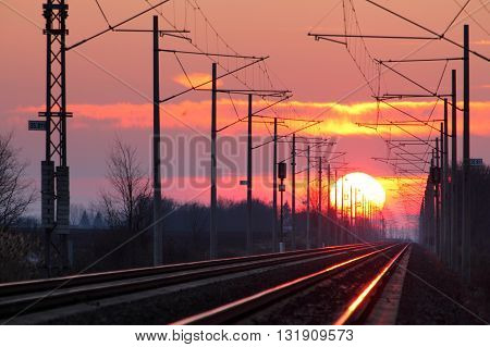 Rrailroad at a sunset with a big sun