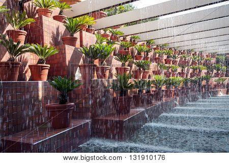 SPAIN, BARCELONA, JUNE, 28, 2015 - Original design drip fountain next to the flower pots in Hotel & Spa Villa Olimpica, Barcelona, Catalonia, Spain.