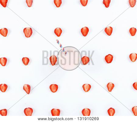 Strawberry smoothie on a white background with strawberry slices. Top view. Flat lay
