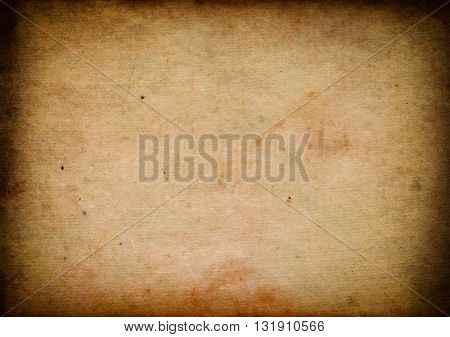 Aging stained paper background with vignette effect.