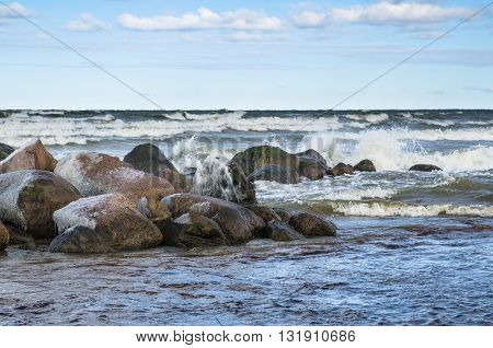 Sea waves breaking on the rocks, seascape