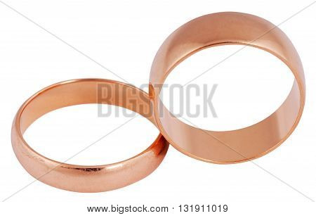Two wedding golden rings isolated on the white background