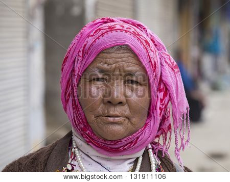 LEH INDIA - JUNE 21 2015: Unidentified beggar woman on the street in Leh Ladakh. Poverty is a major issue in India