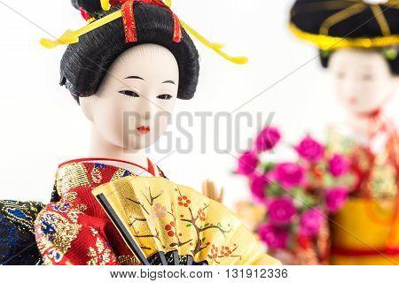 Japanese geisha dolls with folding japanese fan.