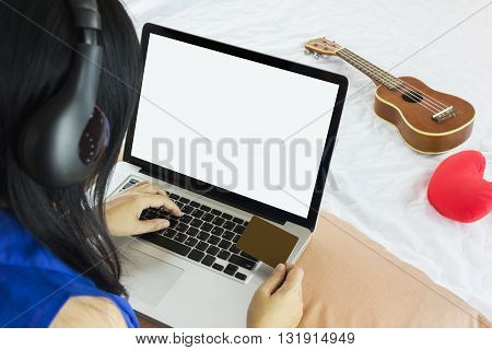 Girl Or Women Rare View With Hand Taking Blank Credit Or Debit Card And Blank Screen Laptop For Onli