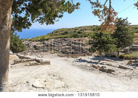 The ruins of the ancient acropolis on a background of a sea landscape on the island of Rhodes in Greece.