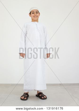 Excited cute Arabic little boy smiling