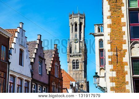 Medieval tower Belfort against blue sky in Bruges, Belgium