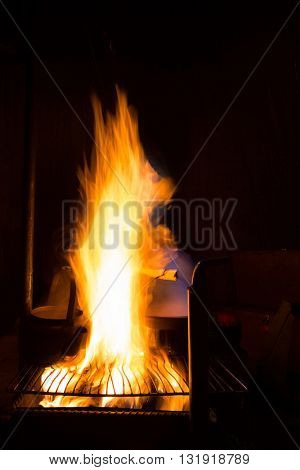 food Preparing on fireplace in wild camping at night