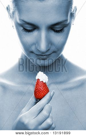 Beautiful young naked girl with red juicy strawberry (toned in blue)
