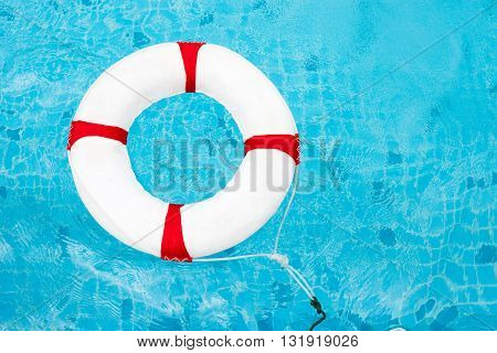 Life Ring At The Swimming Pool. Life Ring On Water. Life Ring On Blue Water