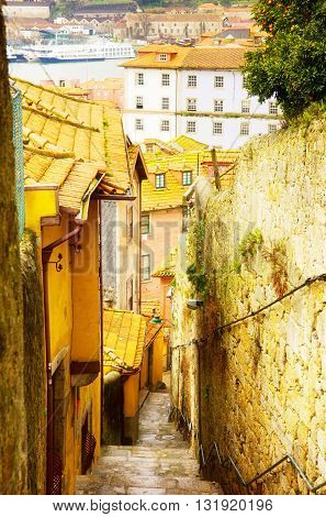 narrow street with stairs in old town, Porto, Portugal, retro toned