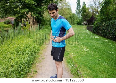Man runner side cramps after running. Jogging woman with stomac side pain after jogging work out.