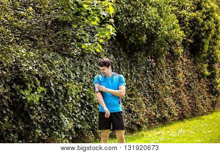 Running workout man with mp3 music player listening to music with mp3 player armband with smart mobile phone.