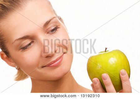 Beautiful girl with an apple isolated on white