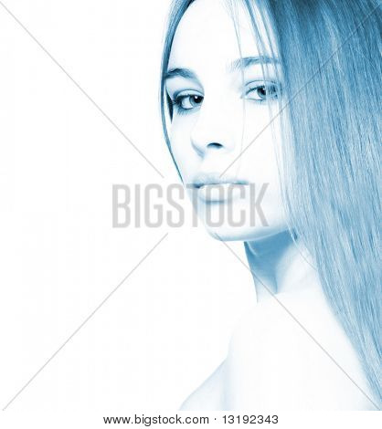 Beautiful girl isolated on white (high-key portrait toned in blue)