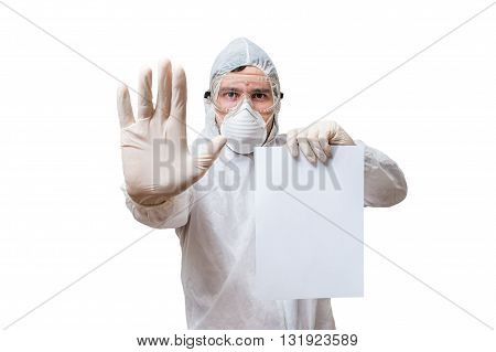 Technician In Coveralls Is Holds Blank Paper For Custom Text. Is