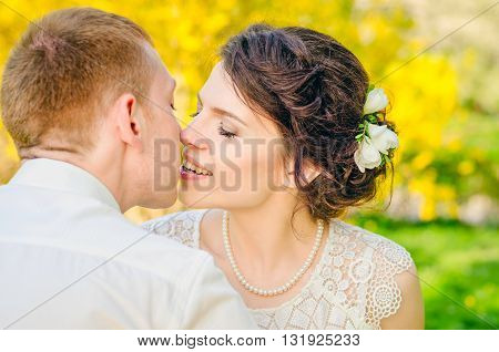 wedding, just married couple kiss in a forest
