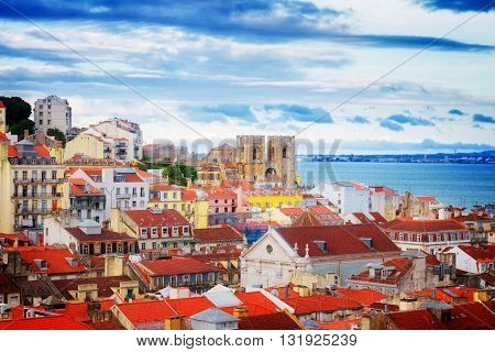 view of Lisbon over old town quarters with Se cathedral, Portugal, retro toned