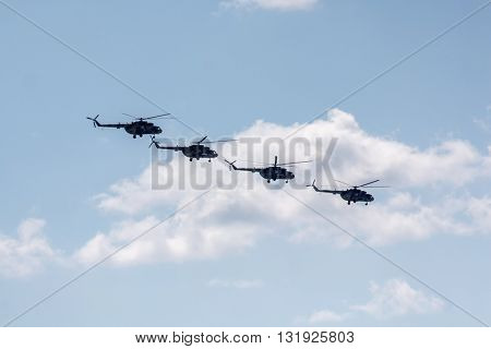 Helicopters flying against the blue sky