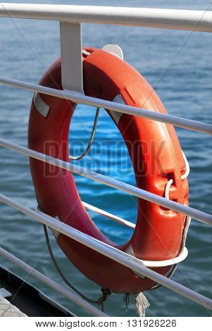 Lifebuoy on board . Close-up view .