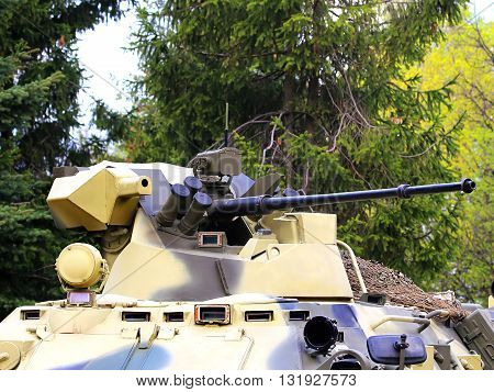 Rotating towerof the armored personnel carrier with 30 millimeter cannon and machine gun