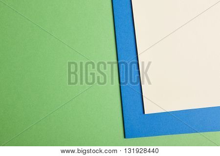 Colored cardboards background in green blue beige tone. Copy space. Horizontal