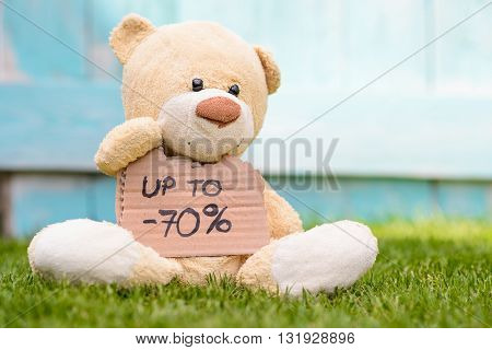 Teddy Bear Holding Cardboard With Information -70%
