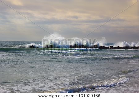 Stormy ocean waves beautiful seascape big powerful tide in action storm weather in a deep blue sea forces of nature natural disaster.