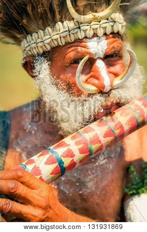 Playing Man In Papua New Guinea