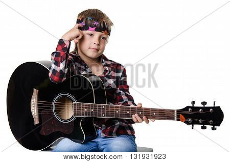 boy sitting and holding the guitar isolated on white background
