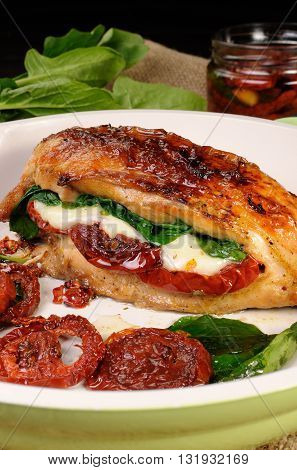 Baked chicken breast stuffed with mozzarella spinach sun-dried tomatoes