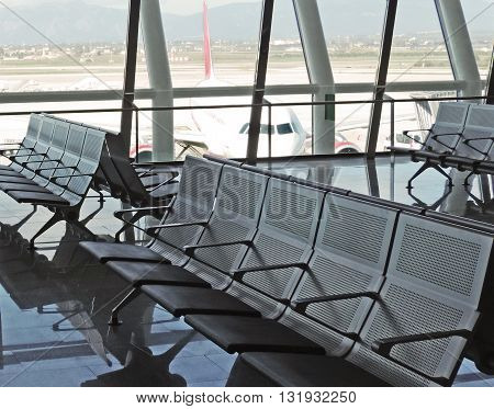 Airport waiting area with empty seats. No people.