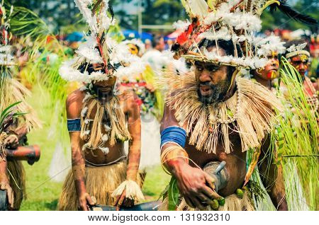 Two Dancers In Papua New Guinea