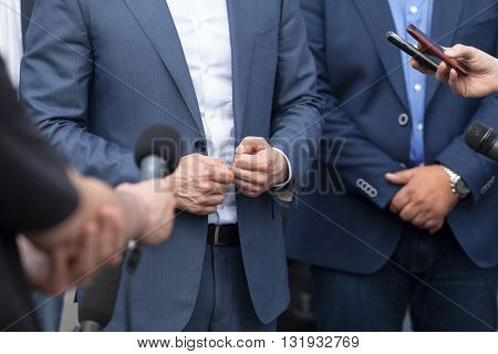 Journalists making interview with businessperson, politician or spokesman. Press conference.