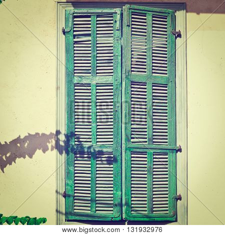 Israel Window with Closed Wooden Shutters in Tel Aviv Retro   Effect