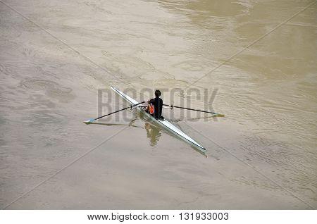 Man Kayaking On Thetiber River In Rome